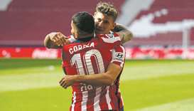 Atletico Madrid's Marcos Llorente (right) celebrates with Angel Correa after scoring a goal during t