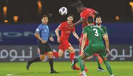 Al Duhail's Michael Olunga heads the ball during their match against Al Ahli in Jeddah Sunday.