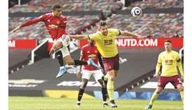 Manchester United's Mason Greenwood (left) jumps to win a header during the Premier League match aga