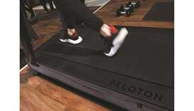 This file photo shows the running deck of a Peloton treadmill.