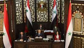 Syrian parliament speaker Hamouda Sabbagh (C) announces that presidential elections in the war-torn