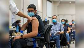 (File photo) A young man get Covid vaccination in Ontario, Canada. (Reuters)