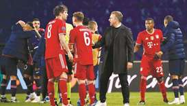 Bayern Munich head coach Hansi Flick (centre) dropped a bombshell on Saturday by revealing he intend