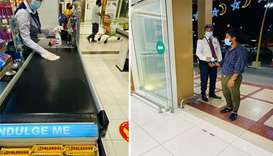 Regular sanitation at a cash counter at a LuLu outlet; Checking of temperatures and Ehteraz mobile a