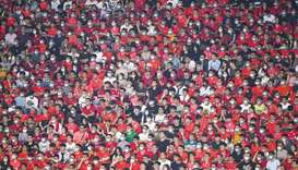 Fans watch the Chinese Super League match between Guangzhou FC and Guangzhou City in China's souther