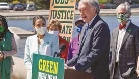 Ocasio-Cortez and Markey at the news conference to re-introduce the Green New Deal, at the US Capito