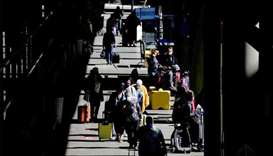 Travellers walk through a pick-up area in the arrivals section at Seattle-Tacoma International Airpo