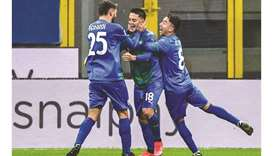 Sassuolo's Giacomo Raspadori (centre) celebrates with teammates after scoring against AC Milan in Mi
