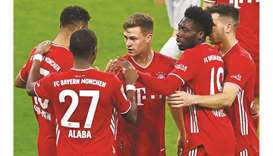 Bayern Munich's Joshua Kimmich (centre) celebrates with teammates after scoring against Bayer Leverk