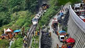 Rescue workers at the site where a train derailed inside a tunnel in the mountains of Hualien, easte