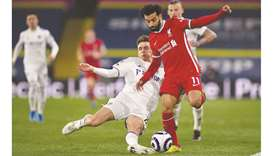 Leeds United's Diego Llorente (left) challenges Liverpool's Mohamed Salah (right) during the Premier