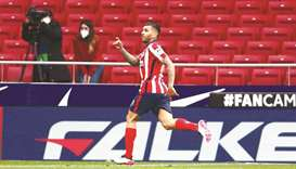 Atletico Madrid's Angel Correa celebrates his goal during the match against Huesca in Madrid, Spain,