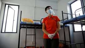 (file photo) Singapore's Minister of Manpower Josephine Teo tours a dormitory room for migrant worke