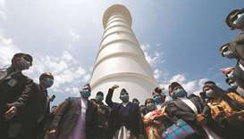Nepal's Prime Minister K P Oli waves towards the media during the inauguration of Dharahara tower, i