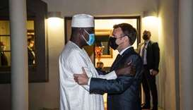 French President Emmanuel Macron greets Chairman of the African Union Commission Moussa Faki Mahamat