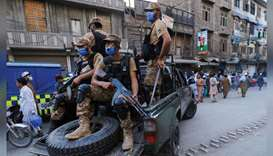 Army soldiers patrol the street, to enforce coronavirus safety protocols, as the spread of the coron