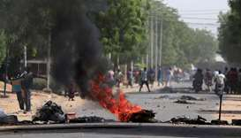 (File photo) Tires burn at a barricade during protests demanding return to civilian rule in N'Djamen