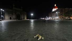 A view of the Gateway of India monument and the Taj Hotel during a curfew to limit the spread of the