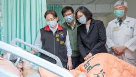 Taiwan President Tsai Ing-wen visits a victim of the deadly train derailment at a hospital in Hualie