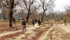 Security force personnel patrol after an attack by Maoist fighters in Bijapur in the central state o