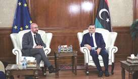 Libya's interim prime minister Abdul Hamid Dbeibah (right) meets with European Council President Cha
