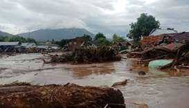 Damaged houses are seen at an area affected by flash floods after heavy rains in East Flores, East N