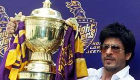 (file photo) Bollywood actor Shah Rukh Khan displays the Indian Premier League (IPL) cricket trophy