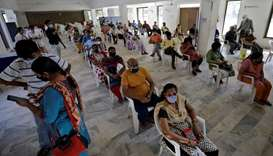 People sit in a waiting area to receive a dose of COVISHIELD, a coronavirus disease (Covid-19) vacci
