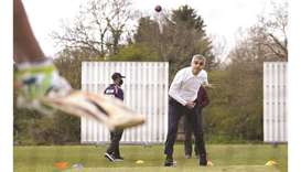 London Mayor Sadiq Khan plays cricket during a London mayoral election campaign visit to Kingstonian