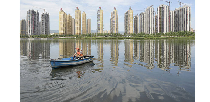 More Chinese cities relax property rules