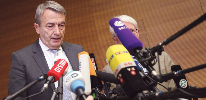 Wolfgang Niersbach (L), President of the German Football Federation (DFB) delivers a statement to an