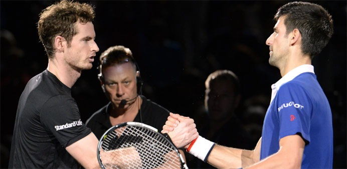 Serbia's Novak Djokovic (R) shakes hands with Britain's Andy Murray after winning the finals