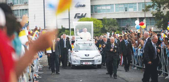 Pope Francis waves upon arriving in Havana's Revolution Square yesterday.