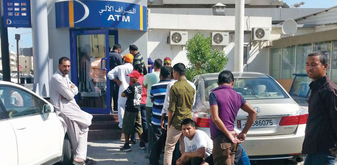 A file picture of workers in front of an ATM
