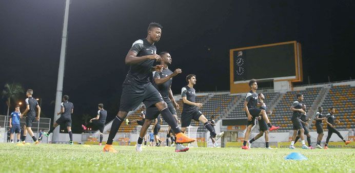 Qatar players  training for today's match against Hong Kong.