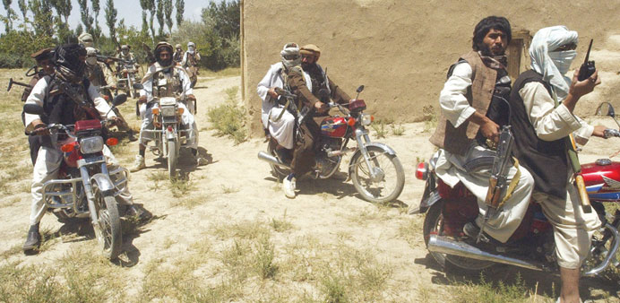 In this file photo, Taliban fighters ride on motorbikes in an undisclosed location in Afghanistan.