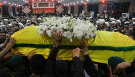 Members and supporters of Hezbollah, carry the coffin of Mustafa Badreddine