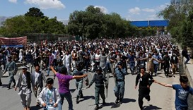 Kabul locked down as thousands protest against power line