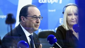 Hollande postpones Middle East conference to summer