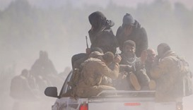 Fighters ride pick-up trucks in Syria
