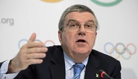Athletes and federations face Olympic doping bans - Bach