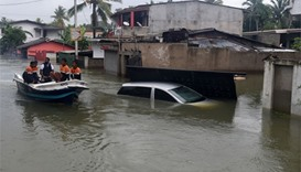Sri Lankan navy personnel evacuate residents following flooding