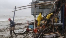 Bangladeshi rescue workers search for survivors after Cyclone Roanu hit Chittagong