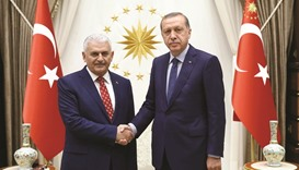 Erdogan ally takes over as PM, vowing stronger presidency