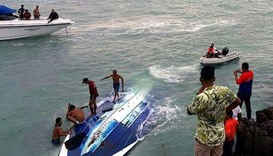 The boat, which was carrying 32 tourists plus four crew, flipped over