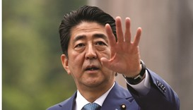 Japan's Abe plans up to $90.7bn stimulus