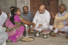 Amit Shah dines with Dalit family