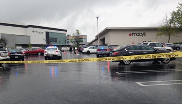 Three victims shot at Maryland mall, suspect at large