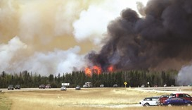 Canada wildfire grows as temperatures rise