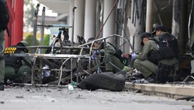 Thai Army investigators take a close look at the site of where a bomb was detonated in the southern